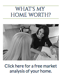 image of a realtor showing customer paper work